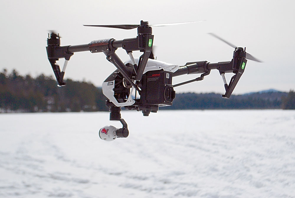A drone, owned and piloted by Robin Johnson of Saranac Lake, hovers in March 2015. (Enterprise photo — Matthew Turner)