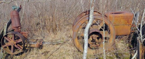 Hidden in a local swamp this old water pump station is slowly rusting away. (Photo — Joe Hackett)