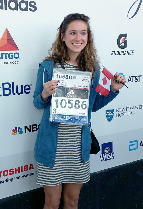 Julie Baird poses for a photo after receiving her bib number for the Boston Marathon. (Photo provided)