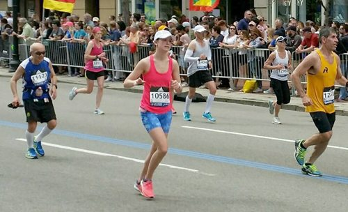 Julie Baird makes her way through the streets of Boston on her way to completing her first Boston Marathon on Monday. Her time of 3:29:12 earned her a spot in next year's race. (Photo provided)