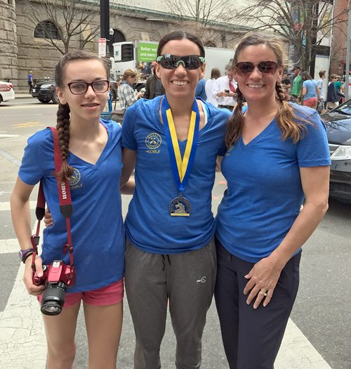 Amy Farrell, center, stands with her daughter Ruby, left, and her sister Tammy Halpern following Monday's Boston Marathon. (Photo provided)