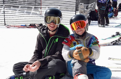 Gunnar and Parker Anthony, of Lake Placid, take a break during the United States Ski and Snowboard Association Nationals last week in Copper, Colorado. Gunnar, 15, won all of his skiercross heats on the way to a first-place finish in the 14- to 15-year-old age group. Parker, 13, placed 25th overall in the 12- to 13-year-old age group. The Anthony brothers regularly compete in Adirondack Series races that take place at Whiteface and Gore mountains, as well as in the Catskill Mountain Series at Windham Mountain. The nationals in Colorado were comprised of more than 800 competitors from around the country and took place over a two-week period. The Anthony brothers were accompanied by their high school alpine coach Kevin Brousseau. (Photo provided)