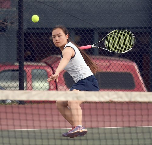 Lake Placid seventh-grader Sonja Toichi returns a shot during her second singles match Wednesday against Plattsburgh. Toichi won in straight sets. (Enterprise photo — Lou Reuter)