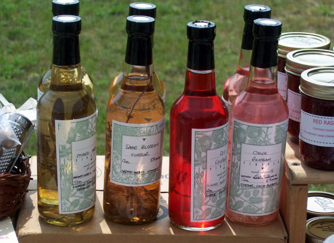 Various vinegars at are on display at a farmers market. (Photo provided — Yvona Fast)