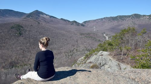 Audrey Levine takes in the views from Owls Head Mountain in Keene in early April. (Enterprise photo — Justin A. Levine)