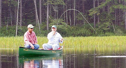 Fishermen stay relaxed as they cast a line in a local pond. (Photo — Joe Hackett)