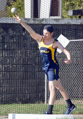 Lake Placid senior Isaac Favata throws the shot put during the Blue Bombers' first track and field meet of the season Thursday at the North Elba Show Grounds. (Enterprise photo — Justin A. Levine)