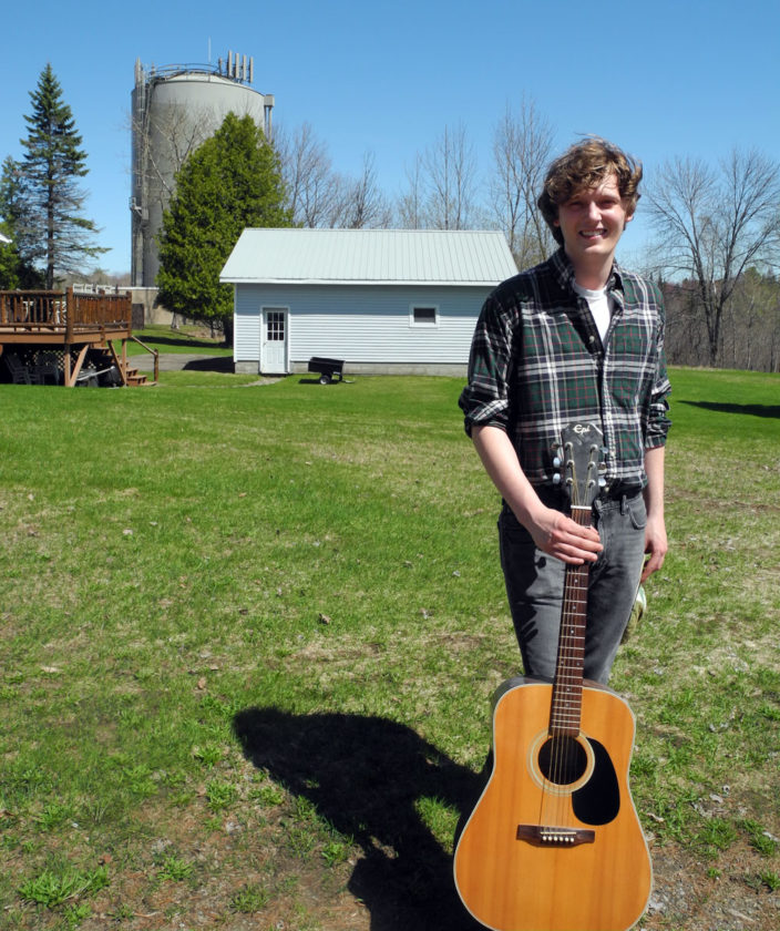 Brock Gonyea stands in the yard of his parents' house in Tupper Lake. (Enterprise photo — Ben Gocker)