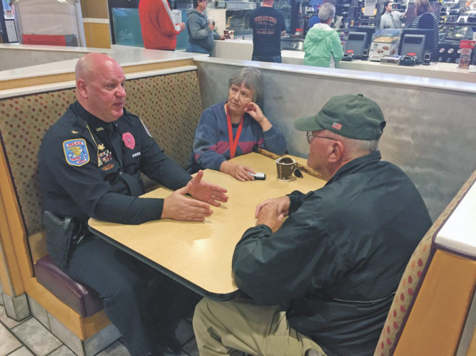 "PHOTO BY SETH WEBER Tiffin Police Department Chief Fred Stevens talks to Patricia and Gene Sherer, of Tiffin, about the string of car break-ins reported Wednesday morning during ""Coffee with a Cop"" Thursday at McDonalds, 1714 W. Market St."