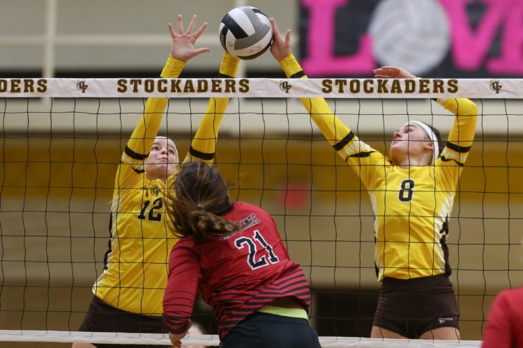 PHOTOBYSTEVEWILLIAMS Old Fort's Morgan Miller (12) and Sydney Clouse team up to block the shot of  Mansfield Christian's Abby Steensland in a Division IV district match Thursday.