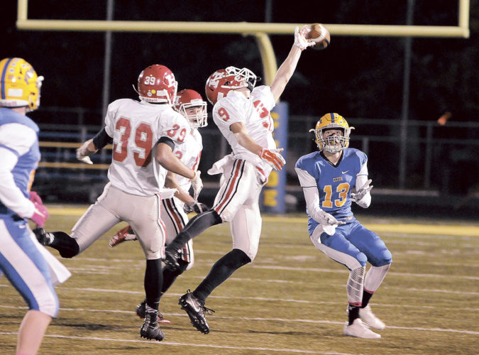 PHOTO BY JONATHON BIRD Huron's Chris Davis breaks up a pass intended for Clyde's Tanner Davenport during the first half Friday.