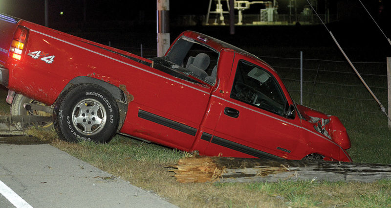 PHOTO BY JILL GOSCHE A Chevrolet pickup truck struck two poles on SR 12 Friday night.