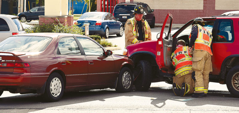 PHOTO BY JILL GOSCHE Tiffin Fire Rescue Division personnel work at the scene of a three-vehicle crash on West Market Street Monday afternoon.