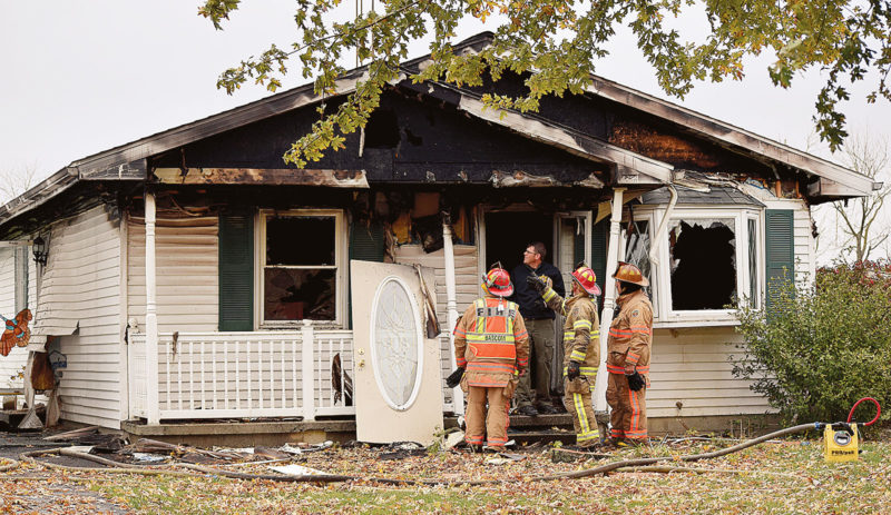 PHOTO BY JILL GOSCHE Bascom Joint Fire District and State Fire Marshal's Office personnel work at the scene of a house explosion and fire Thursday morning.