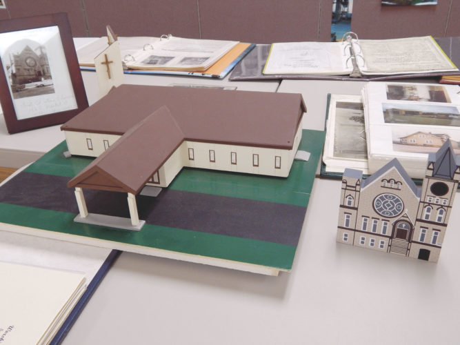 PHOTO  BY MARYANN KROMER These models depict the original First Christian Church and the present building.