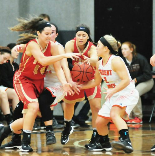 PHOTO BY PAT GAIETTO Heidelberg's Theresa Jackson (left) and Maddi Stiles go for a loose ball against Otterbein's Dani Kissel (left) and Abbi Miduri.