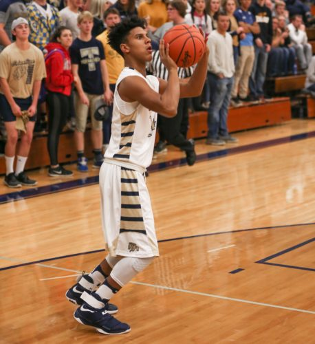 PHOTOBYSTEVEWILLIAMS Columbian's Donnell Brockington puts up a jumper in the third quarter of Friday's game against Kenton.