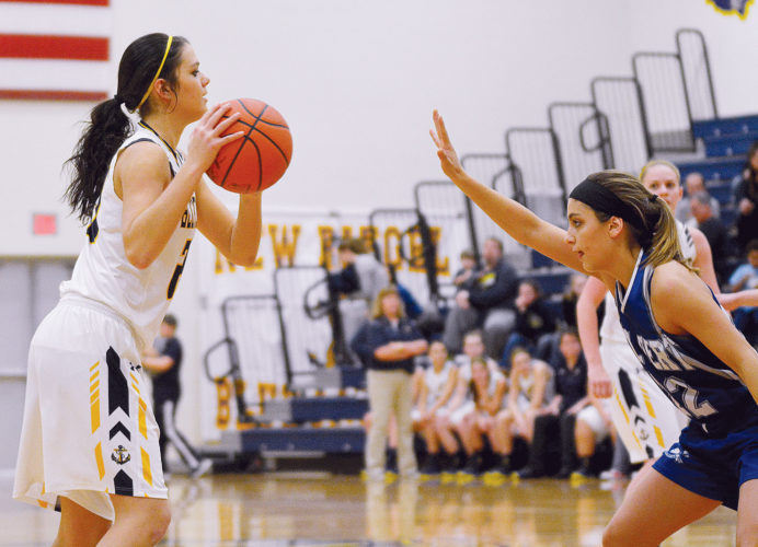 PHOTO BY JILL GOSCHE New Riegel's Brianna Gillig controls the ball against the defense of Calvert's Clare Sullivan during the game in New Riegel Tuesday.