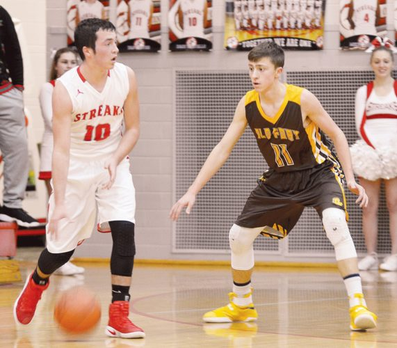 PHOTO BY JILL GOSCHE  Old Fort's AJ Steyer defends St. Joe's Zach Militello during the game in Fremont Thursday.