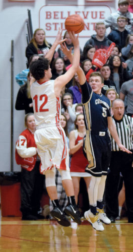 PHOTO BY JILL GOSCHE  Bellevue's Cody Snyder shoots a 3-pointer that tied the score and sent the game into overtime over the defense of Columbian's Jakob Amory during the game in Bellevue Friday.
