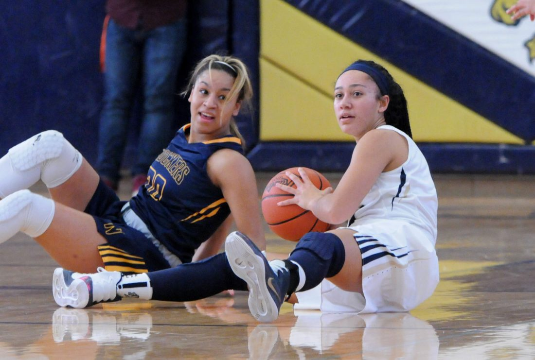 PHOTO BY JONATHON BIRD Columbian's Jada Reaves looks to pass as Norwalk's Jiselle Thomas falls behind her Saturday in Tiffin.