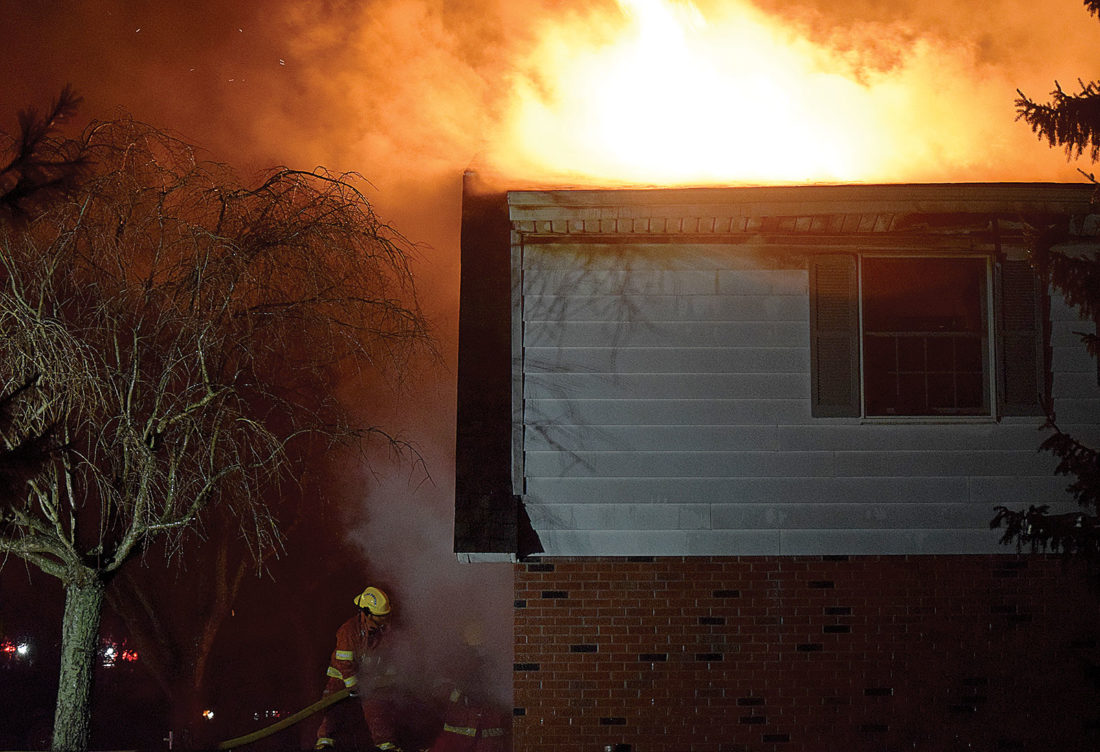 PHOTO BY JILL GOSCHE Flames shoot from the house at 50 W. CR 6 Monday.