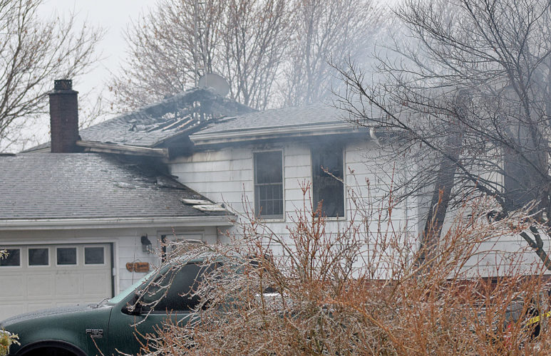 PHOTO BY JILL GOSCHE The house at 50 W. CR 6 burns Tuesday morning.