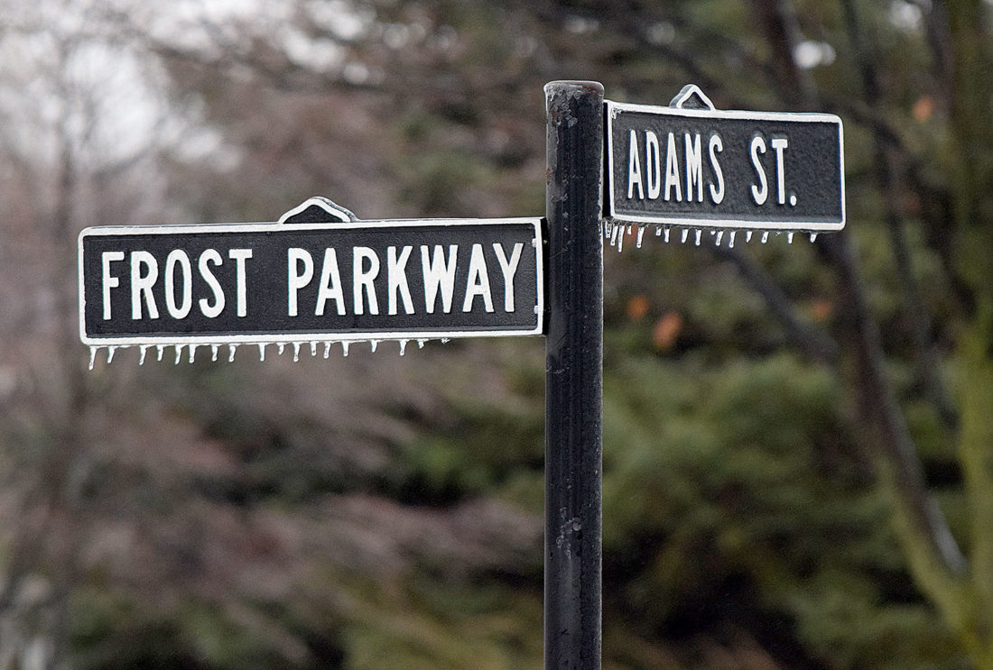 PHOTO BY JILL GOSCHE Ice hangs on the street signs for Frost Parkway and Adams Street in Tiffin Tuesday morning.