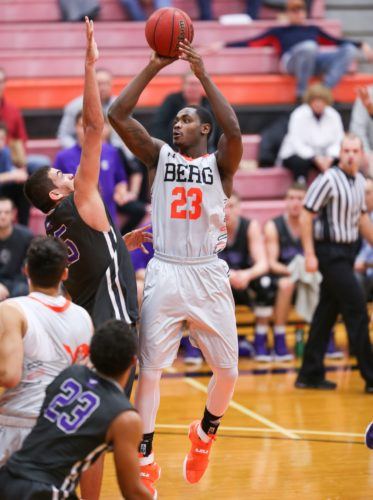 PHOTOBYSTEVEWILLIAMS Heidelberg's Myron Prewitt shoots beyond the defense of Capital's Tyler Jamison Wednesday at Seiberling Gymnasium.