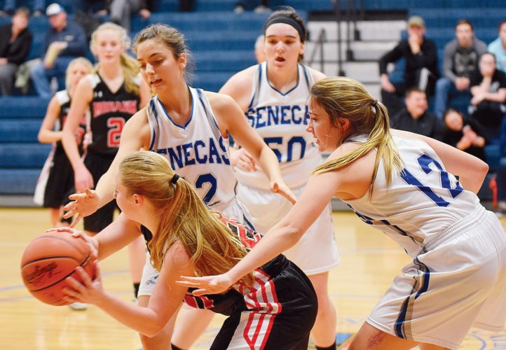 PHOTO BY JILL GOSCHE Mohawk's Aubrey Margraf is guarded by Calvert's Clare Sullivan (from left), Allie Beckley and Shelby Hemminger during the game in Tiffin Thursday.