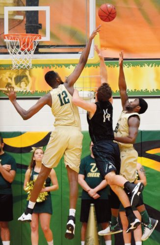 PHOTO BY JILL GOSCHE  Tiffin University's Mohamed Rage (12) and Juwan Johnson defend Lake Erie's Brogan Scott during the game in Tiffin Thursday.