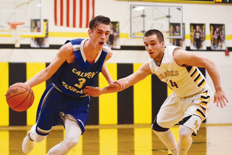 PHOTO BY JILL GOSCHE Calvert's Connor Meyer controls the ball against the defense of St. Wendelin's Brayden Moon during the game in Fostoria Friday.