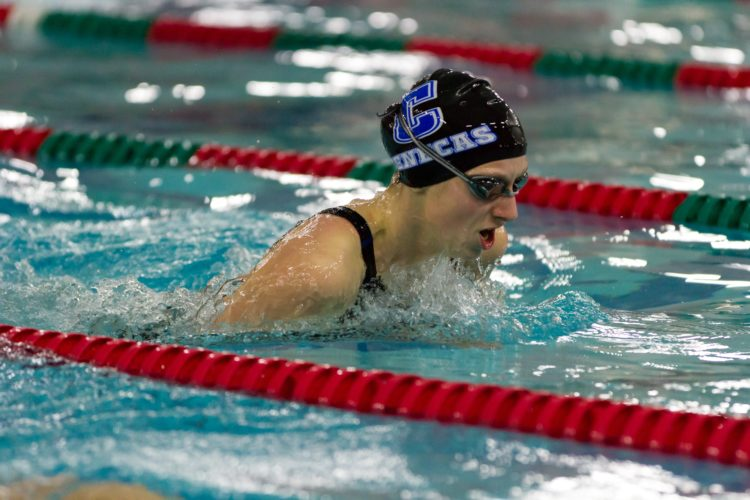 PHOTOSUBMITTED Calvert's Taylor Harris competes in the 100 breast at the Sandusky Bay Conference Championships in Oak Harbor Saturday. Harris won the race.