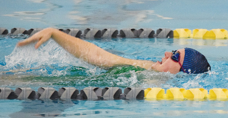 PHOTO BY JILL GOSCHE Columbian High School senior Beca Kimmet swims during the mock meet at Tiffin Community YMCA Monday afternoon.