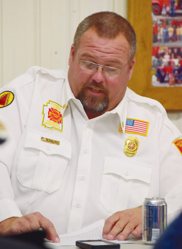 PHOTO BY JILL GOSCHE Chief Rob Miller of McCutchenville Volunteer Fire Department gives his report during the fire department's annual meeting at the fire station Monday night.