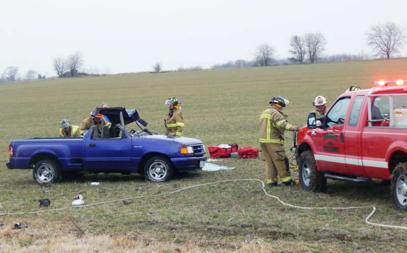 PHOTO BY SETH WEBER Emergency responders work on moving a Ford Ranger after it rolled over at SR 12 and TR 57 Thursday afternoon.