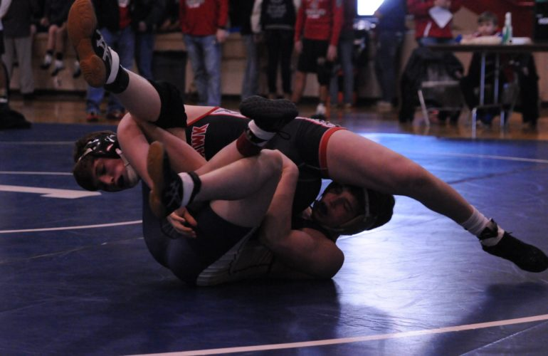 PHOTOS BYJONATHONBIRD Mohawk's Morgan Price (top) gets tied up with Columbian's Dustin Yates during the fifth annual Gene Kimmet Invite Saturday in Tiffin. Price won the 138-pound title.