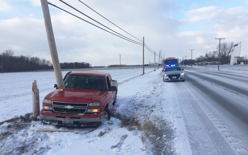 PHOTO BY SETH WEBER A 2006 Chevrolet Silverado (left) snapped a telephone pole at SR 53 and CR 592 after it slid off the road Thursday afternoon.