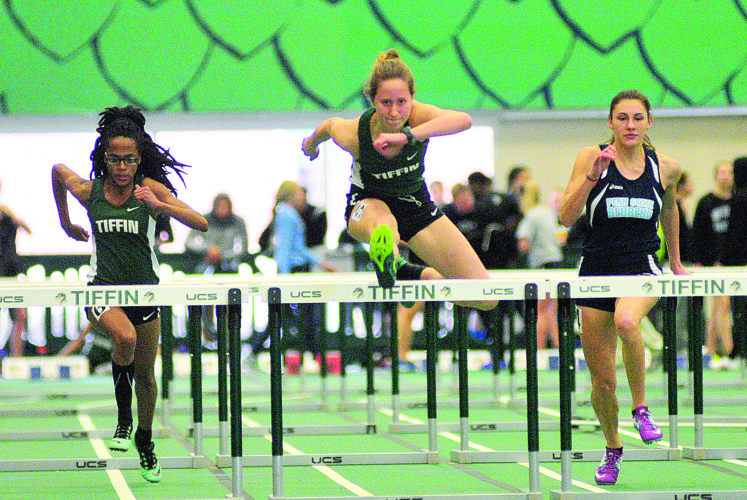 PHOTO BY PAT GAIETTO Tiffin University's  Emma Gielink (center) and Mirah Mackey (left) compete in the 60 meter hurdles.