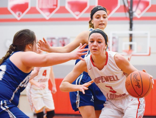 PHOTO BY JILL GOSCHE Calvert's Claire Thompson (left) and Clare Sullivan defend Hopewell-Loudon's Alexis Feindel during the game in Bascom Monday.
