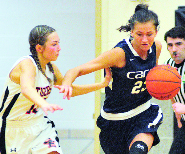 PHOTO BY PAT GAIETTO Carey's Sydney Kin pushes the ball up court against Seneca East's Marina Adachi in Attica.