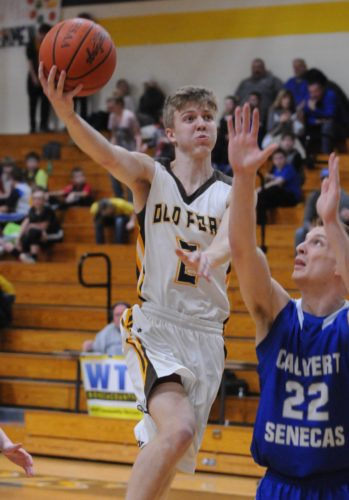 PHOTO BY JONATHONBIRD Old Fort's Hootie Cleveland drives to the hoop past the reach of Calvert's Alex Keller Friday.