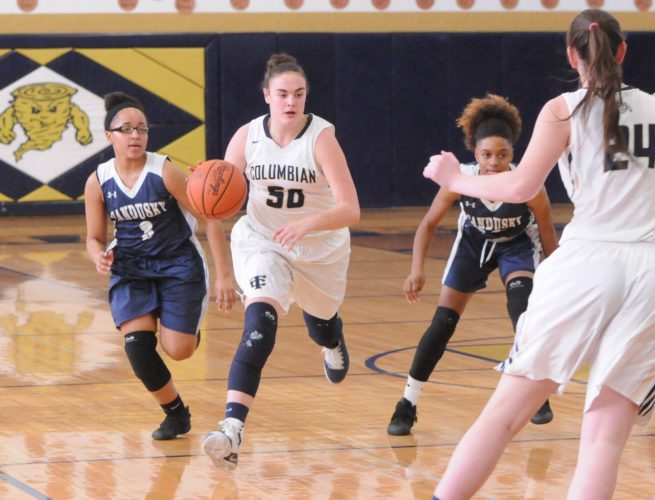 PHOTOBYJONATHONBIRD Columbian's Madalyn Brisendine splits a pair of Sandusky defenders as teammate Abby Dryfuse looks on in Tiffin.
