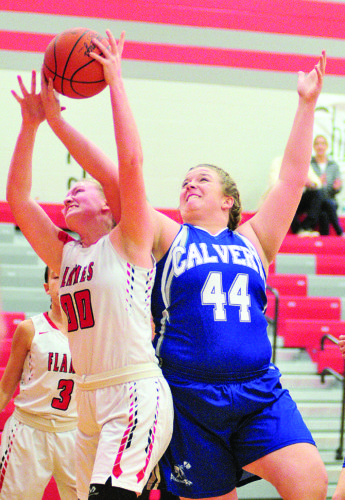 PHOTO BY PAT GAIETTO Calvert's Kristan Bowers tries to get a rebound away from Mansfield Christian's Heidi Smith during a Division IV sectional game in Bascom. Bowers had 13 points and 11 rebounds.