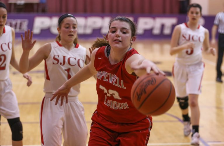 PHOTOBYSTEVEWILLIAMS Hopewell-Loudon's Brooklyn Arbogast chases down a loose ball under the basket ahead of St. Joe's Ava Stepanic (1) during a Division IV first-round game at Fremont Ross.