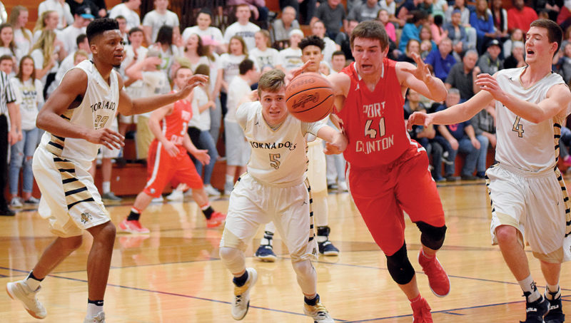 PHOTO BY JILL GOSCHE Columbian's Jakob Amory (second from left) and Port Clinton's Joey Brenner fight for the ball as Columbian's Ro Durham (left) and Daniel Bupp assist during the game in Tiffin Tuesday.
