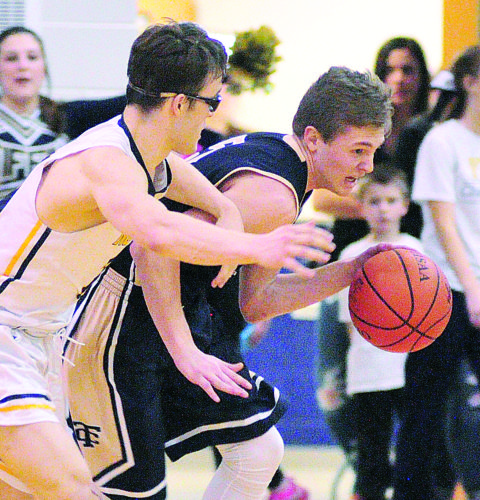 PHOTO BY PAT GAIETTO Columbian's Jakob Amory drives past against Norwalk's George Friend Friday.