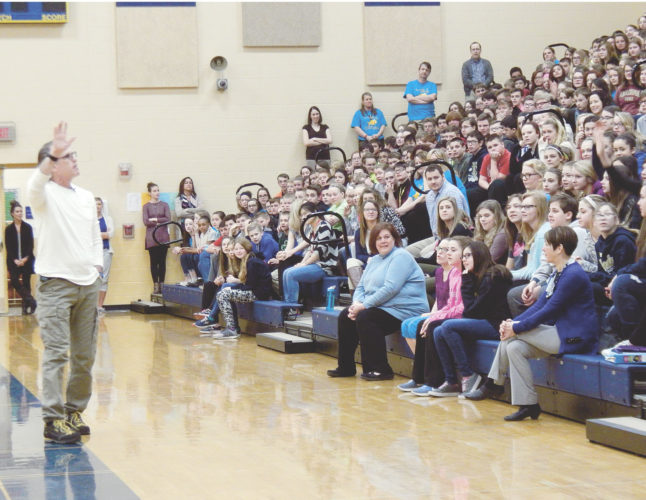 PHOTO BY NICOLE WALBY Motivational speaker David Flood talks to Tiffin Middle School students Tuesday morning.