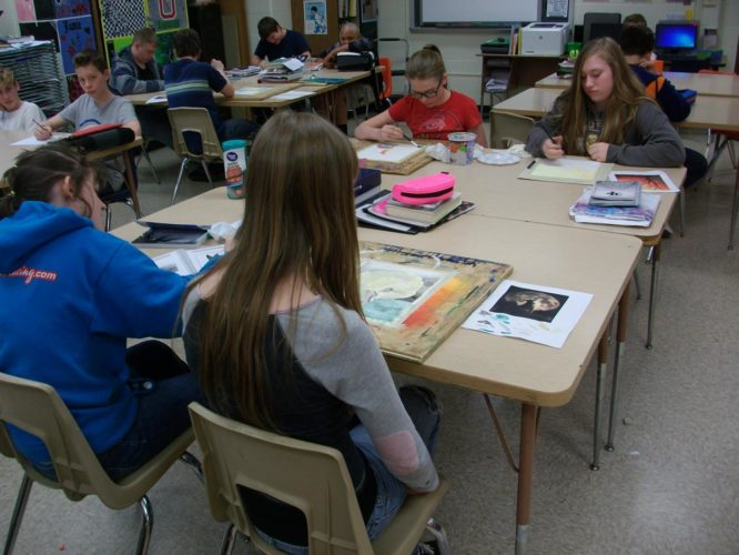 PHOTO SUBMITTED Old Fort High School art teacher Julie Wax's eighth grade students work on watercolor paintings which are to be entered into the Seneca-Wyandot County Art Show March 10.