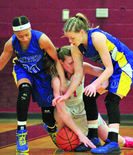 PHOTO BY PAT GAIETTO Bellevue's Payton Vogel tries to gain control of a loose ball from Ontario's Nashail Shelby (left) and Emily Yeager Thursday in the Division II district semifinals in Willard.